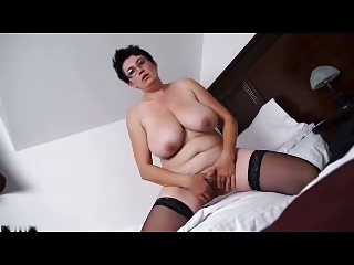 bulky mature brunette undresses and masturbates