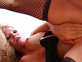 golden-haired momma in red pants and fishnet