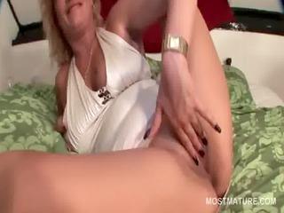 blonde older lady masturbating sweet pussy in sofa